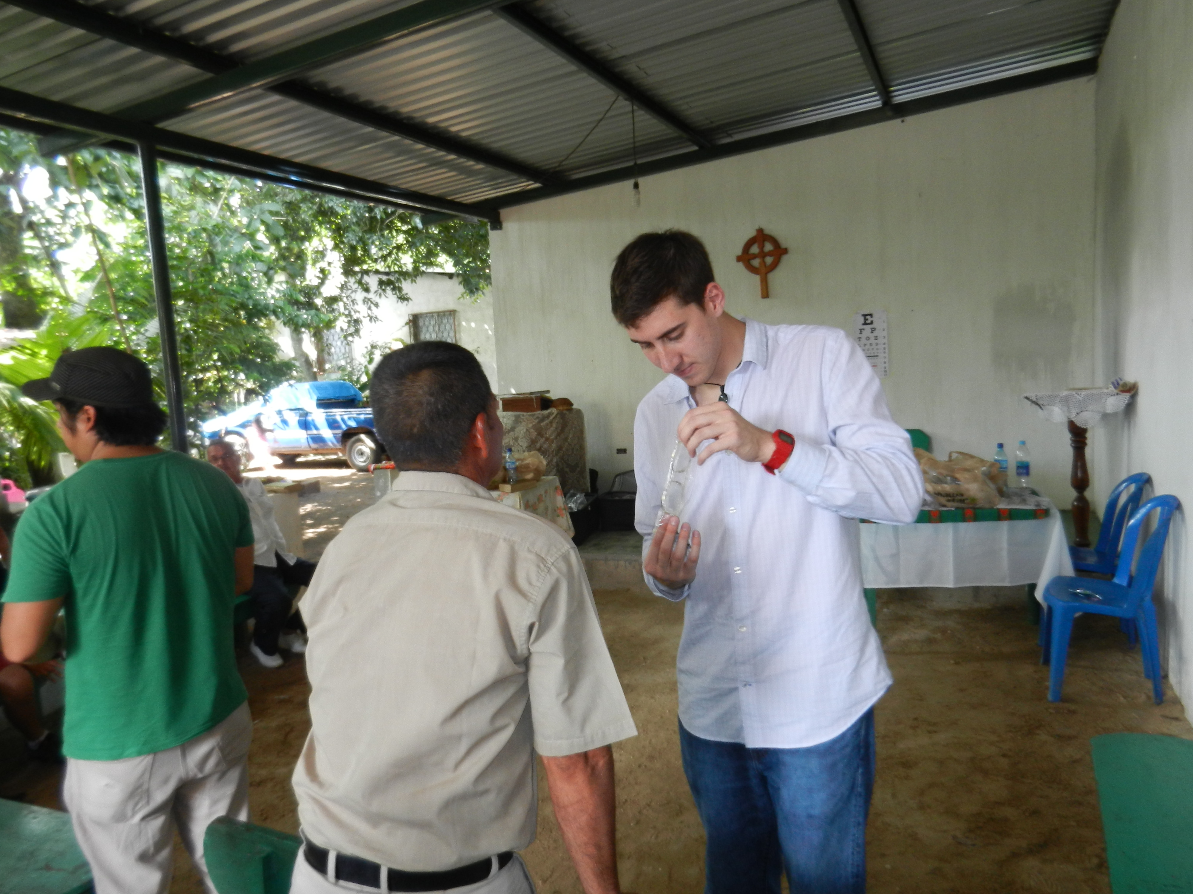 Glasses for Guatemala's founder Garred Greenberg helps distribute glasses at a makeshift clinic in rural Guatemala. (2013)