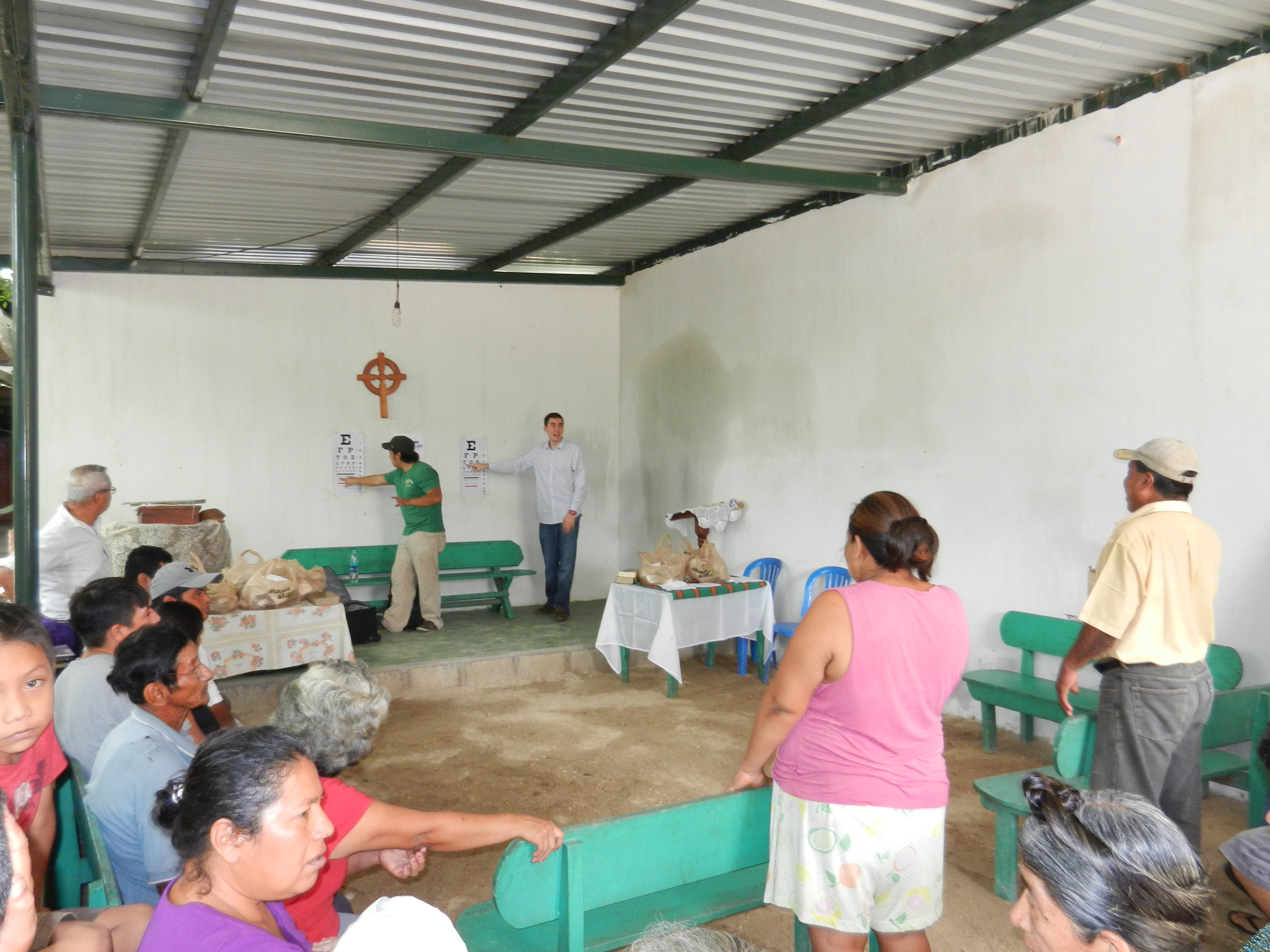 Garred and a Concejo Ecumenico volunteer working side by side to assess visual acuity.