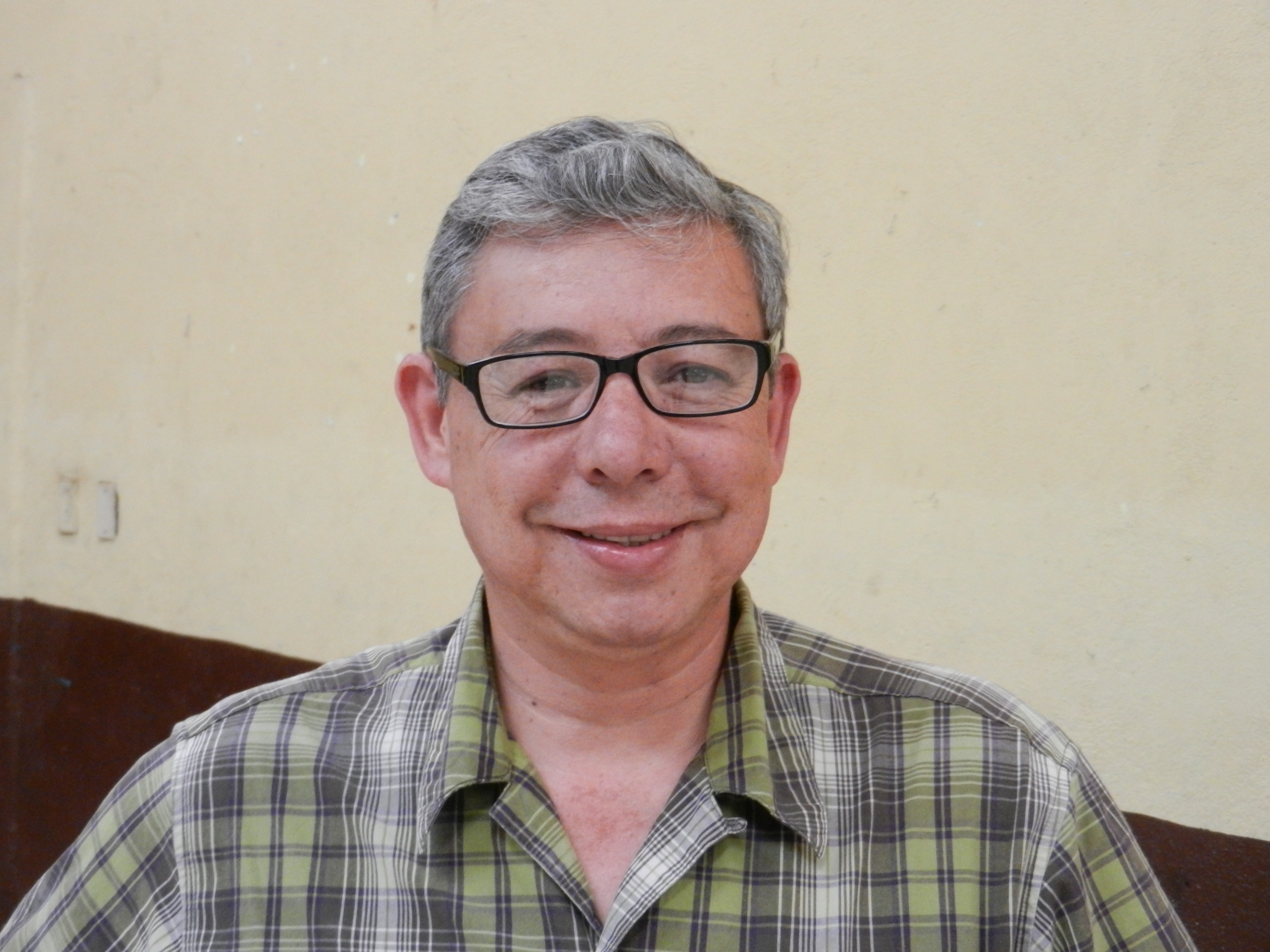 A gentleman pleased with the eyeglasses given to him at the G4G clinic.