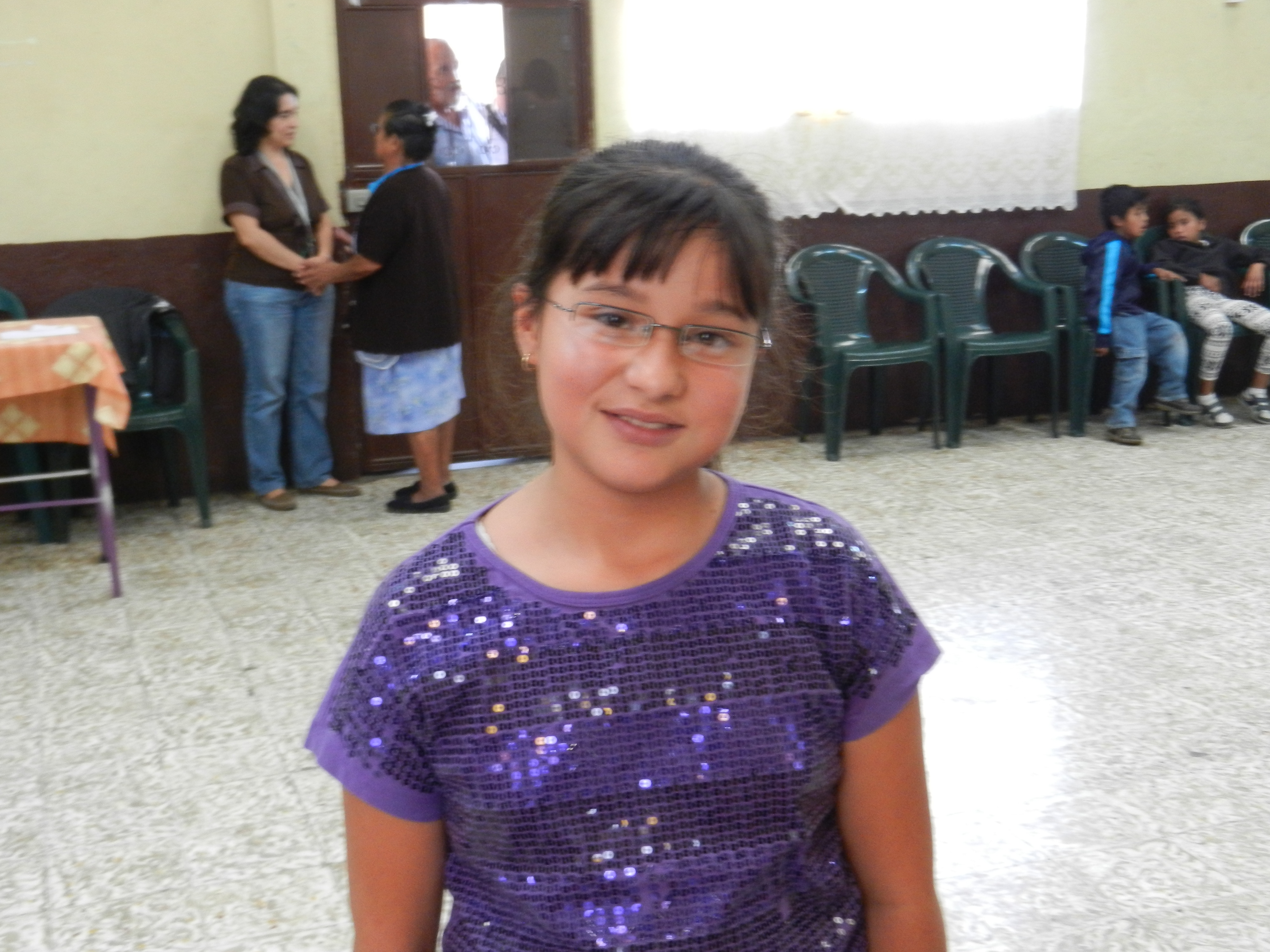 A young girl after receiving her glasses at the Mixco clinic.